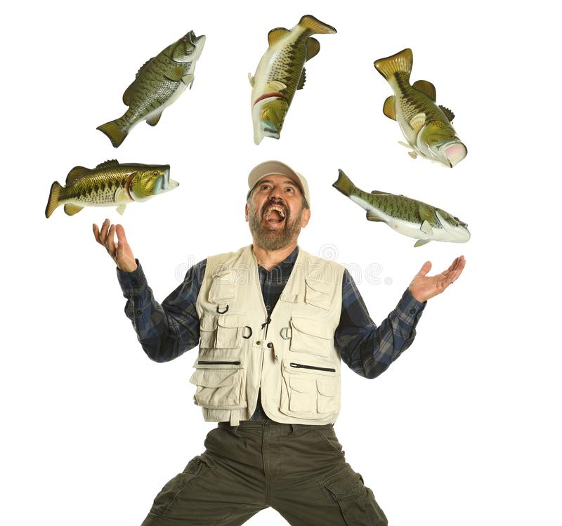 Fisherman juggling with fish showing excitemment royalty free stock photo