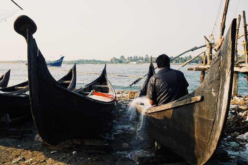 Fisherman in Kochi stock photography