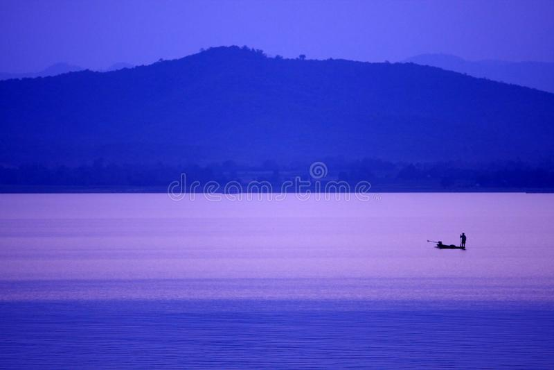 The fisherman in Kraseaw Dam,Thailand