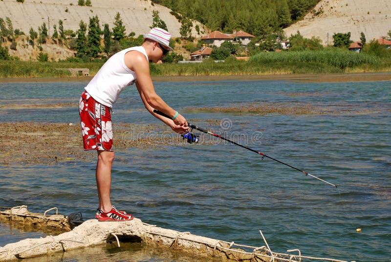 Download Fisherman On The Lake Editorial Image - Image: 19361495