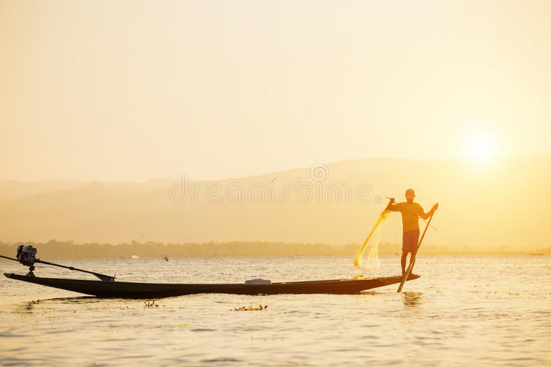 Fisherman of Lake in action when fishing royalty free stock photo