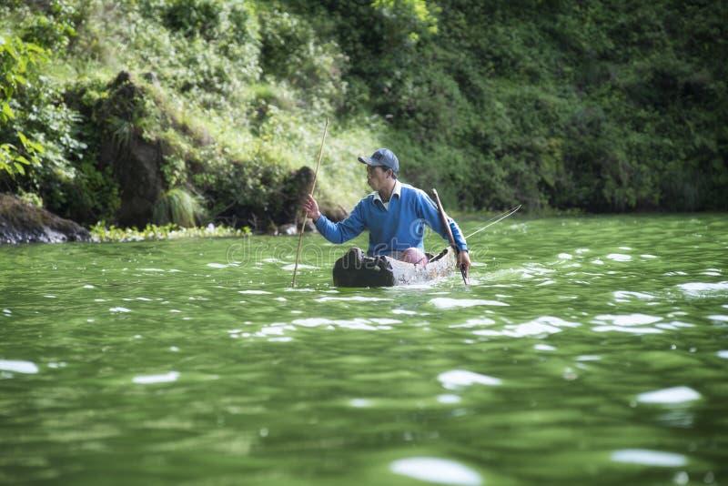 Fisherman on Lake Batur at Trunyan, Bali royalty free stock photos