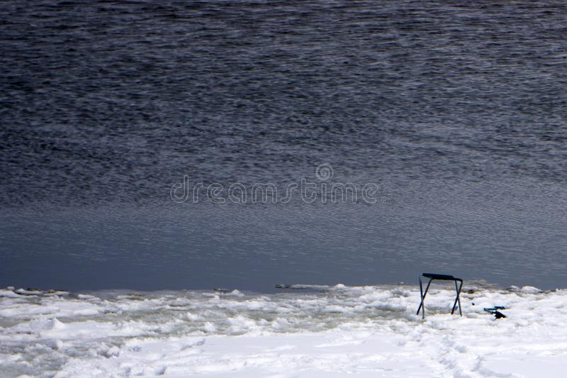 Fisherman looks with this camcorder presence of fish under the ice . royalty free stock images