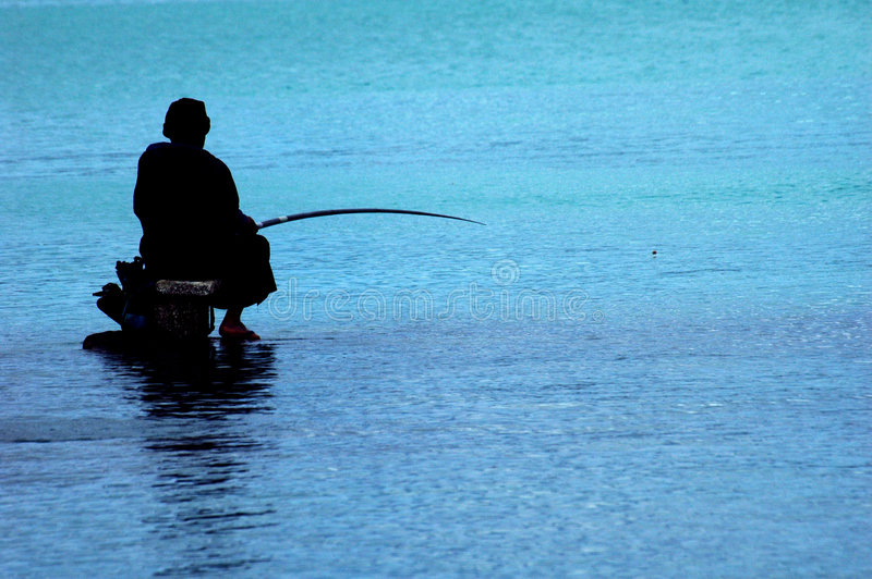 Fisherman at Mauritius stock photo