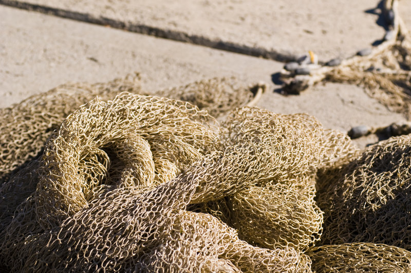Fisherman net. Dry fisherman net on the dock with ropes - in Italy 2007 stock photography
