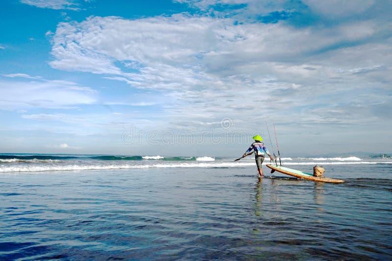 Fisherman in the ocean. royalty free stock photos