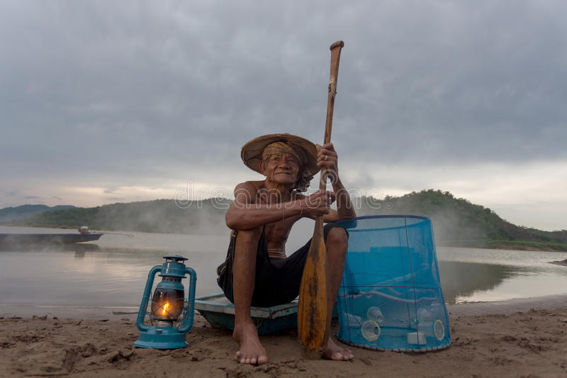 Fisherman old alone stock photos