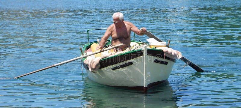 Fisherman Paxos royalty free stock photo