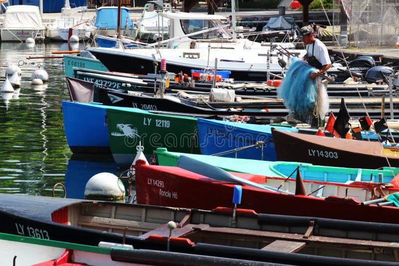 Fisherman preparing his boat in french Port de Rives, Thonon-les-Bains stock photo