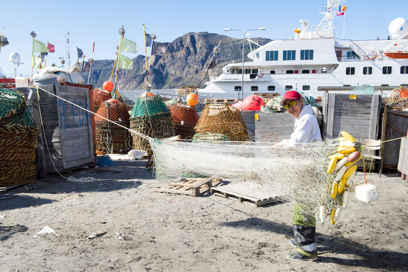 Greenlandic fisherman preparing nets royalty free stock images