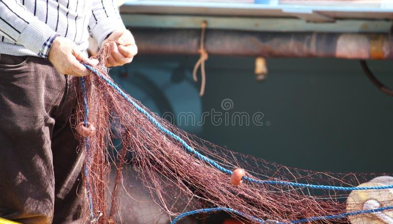 Fisherman pulling net royalty free stock image