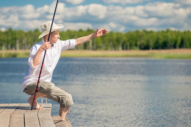 A fisherman in rural clothes on a fishing trip stock image