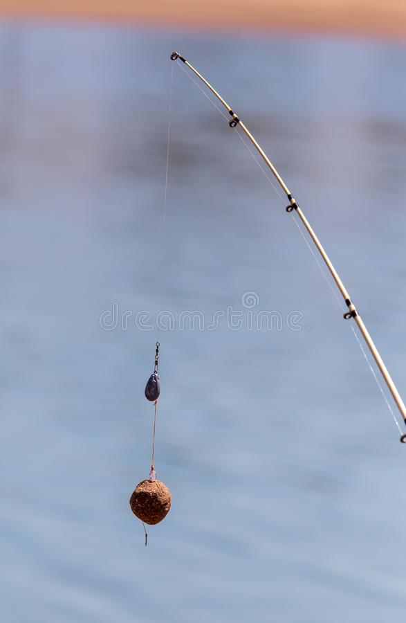 Fisherman`s equipment on fishing line fishing rods stock images