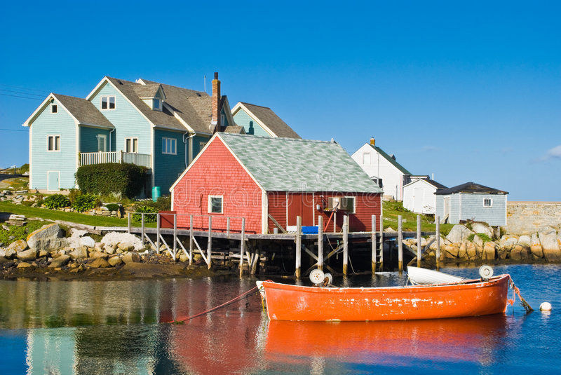 Fisherman's house and boats. Fisherman's house and boats in a bay. Peggy's cove, Canada stock photos