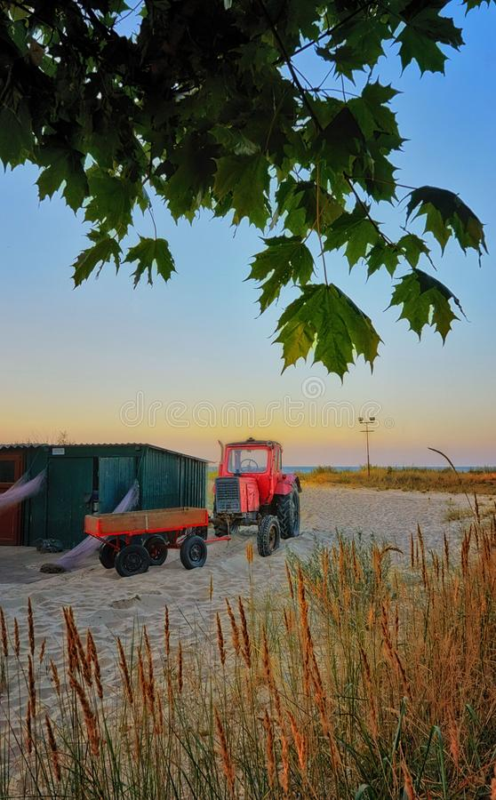 Fisherman's house with red tractor on the beach in Ahlbeck. Germany royalty free stock photography