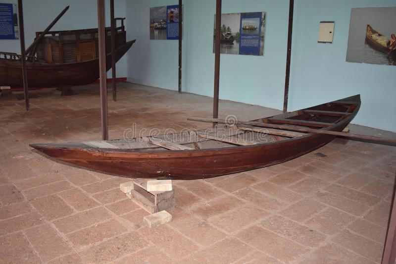 Indian old fishing boat The history of boats. Fisherman`s old fishing boat at Odisha state museum Cuttack, Odisha, India. Built from wood. In which the poor stock photography