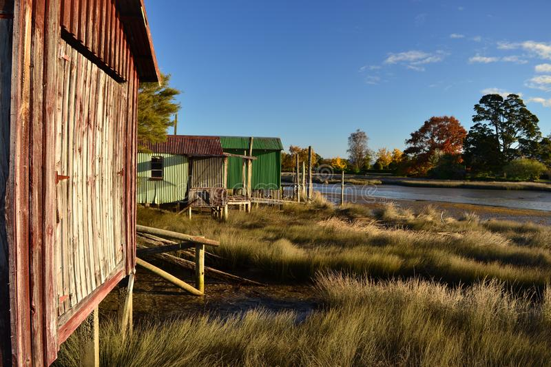 Colorful sheds by the river bank for fisherman royalty free stock photos