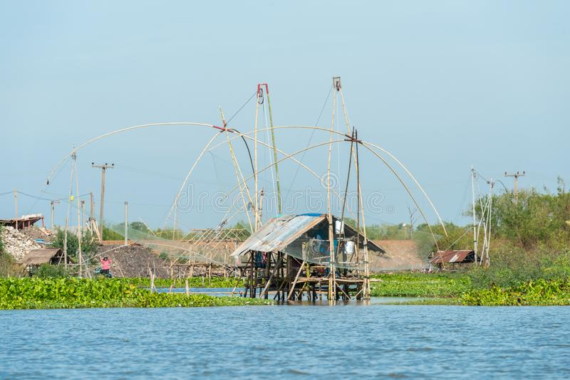 Fisherman`s village in Thailand with a number of fishing tools called `Yok Yor`, Thailand`s traditional fishing tools that made fo. Rm bamboo and fishing net. at stock photography