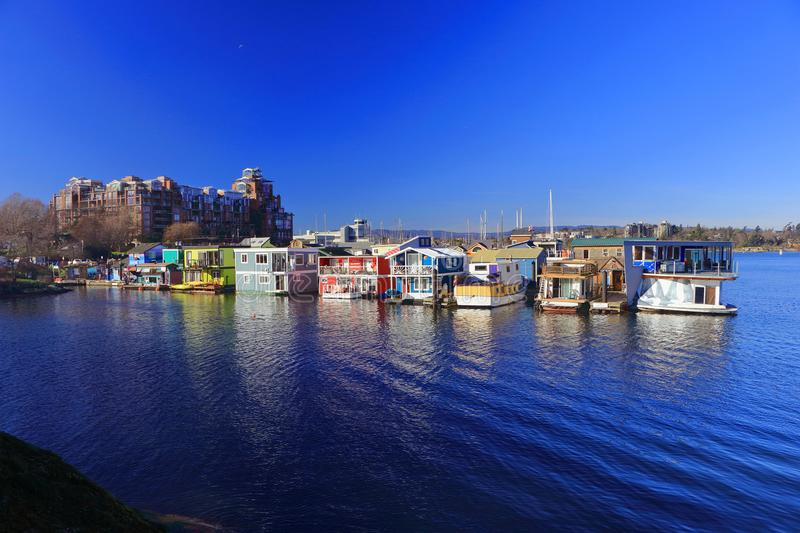 Boathouses at Fisherman`s Wharf at the Inner Harbour in Victoria, Vancouver Island, British Columbia, Canada. Fisherman`s Wharf boasts a beautiful collection of royalty free stock photography