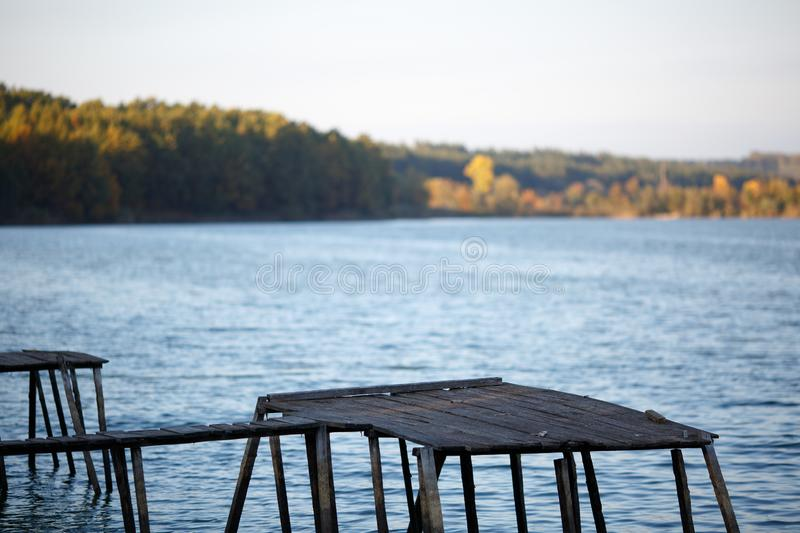 Fisherman`s wooden pier against the big lake royalty free stock photos