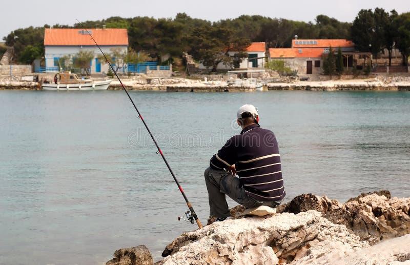 Fisherman at sea fishing stock photos