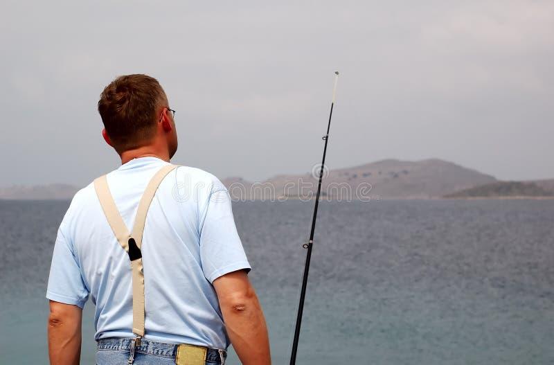 Fisherman at sea fishing royalty free stock photo
