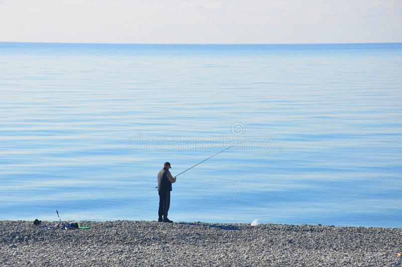 Fisherman by the sea stock image