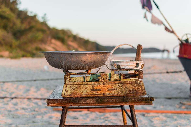 Fisherman selling fish straight from boat after morning catch.  royalty free stock photos