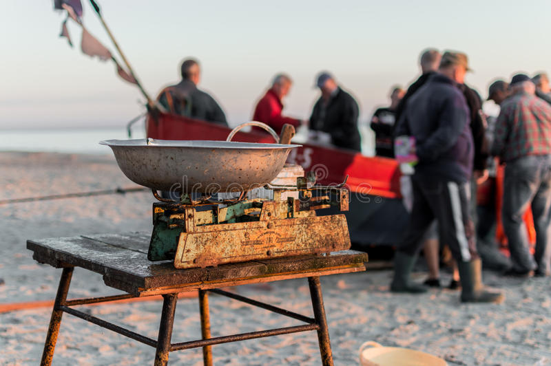 Fisherman selling fish straight from boat after morning catch.  royalty free stock photography