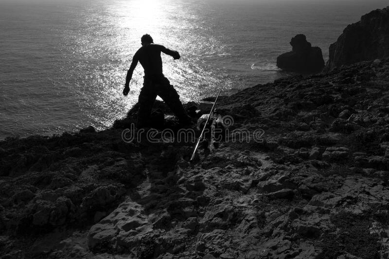 Fisherman on shore royalty free stock photography