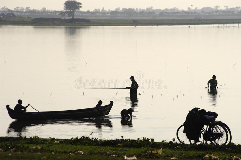 Fisherman Silhouette near U Bein bridge. royalty free stock image