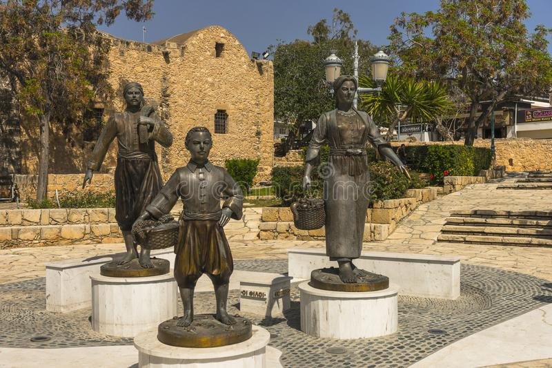 Agia Napa monument. Fisherman , son and wife statue in Ayia Napa , Cyprus Island . Europe . All family monuments stock images