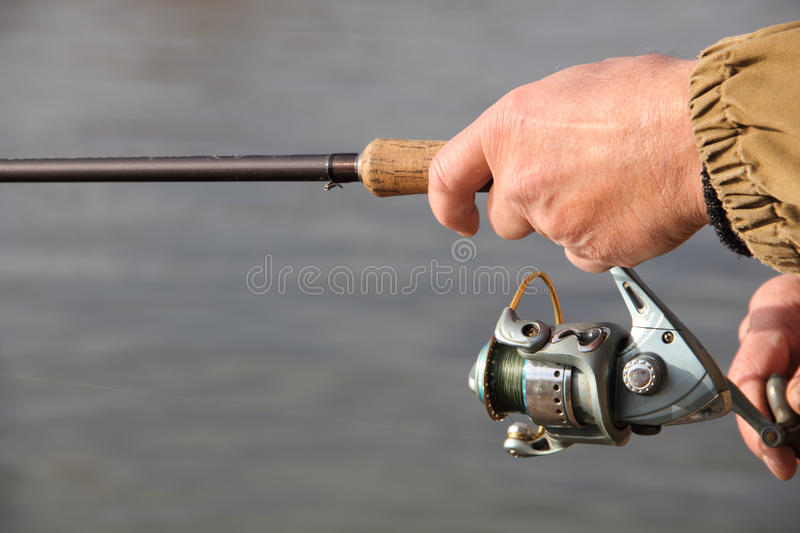 Download Fisherman with spinning stock photo. Image of shelf, male - 24427524