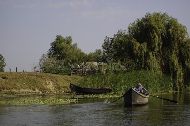 Fisherman at Sulina Danube Delta royalty free stock photography