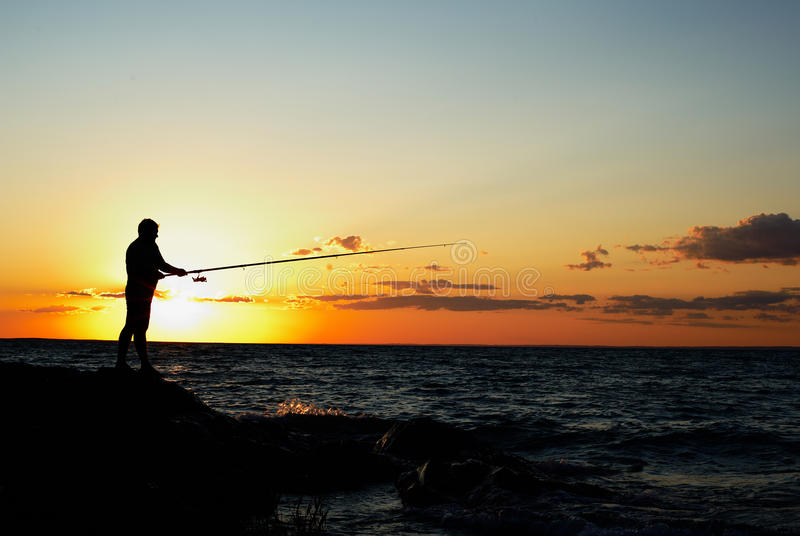 Fisherman At Sunset Stock Images