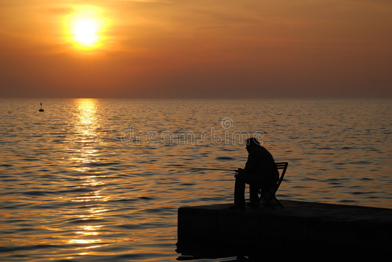 Fisherman sunset stock photography