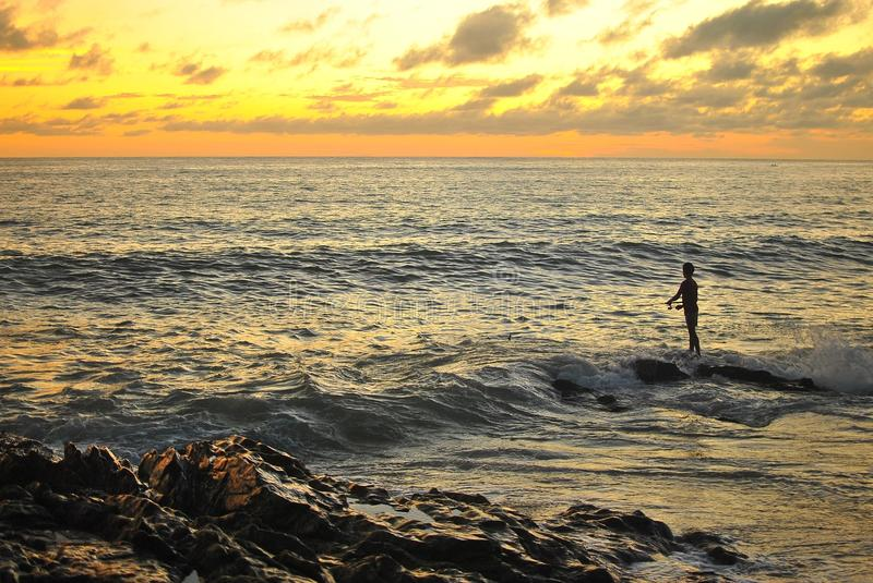 Download Fisherman and sunset beach stock image. Image of seascape - 34296977