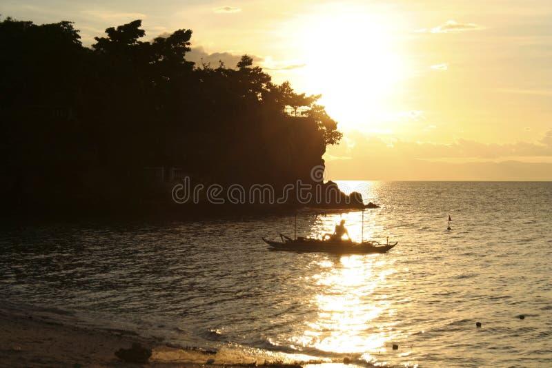 Fisherman at sunset royalty free stock photo