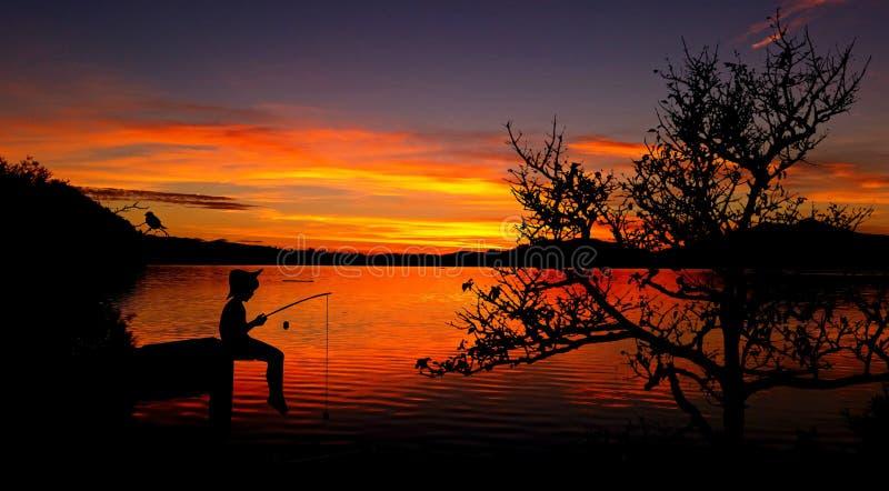 Fisherman at sunset stock photos