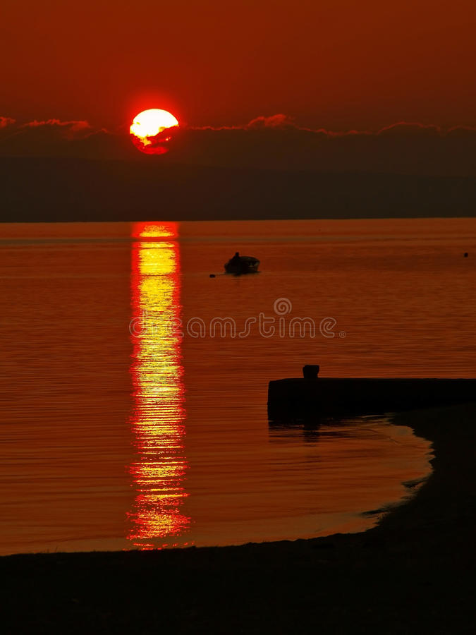 Fisherman in sunset royalty free stock images