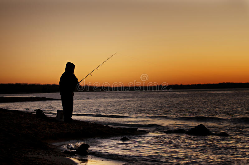 Fisherman @ sunset royalty free stock images