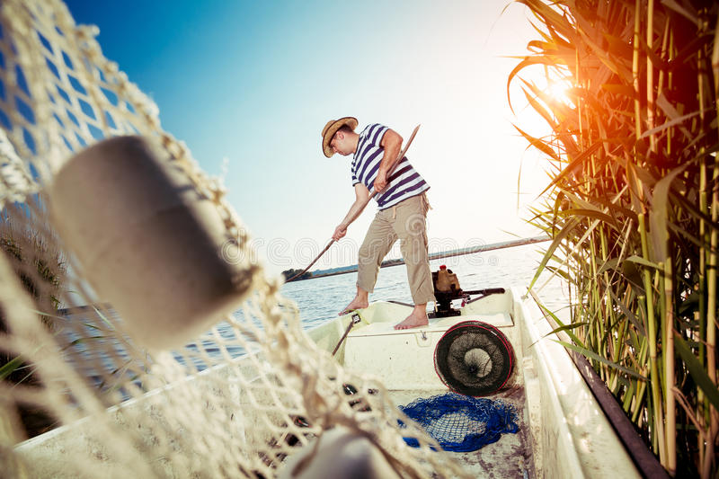 Fisherman taking out the fishing net royalty free stock photography