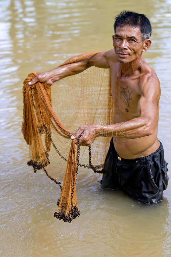 Fisherman of Thailand with throw net stock photos