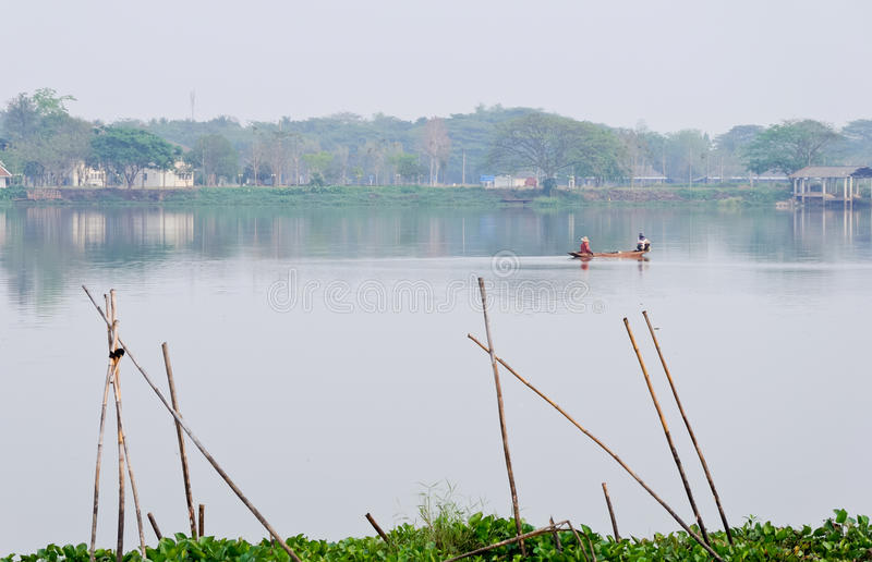 Download Fisherman in tranquil lake stock image. Image of green - 18396079