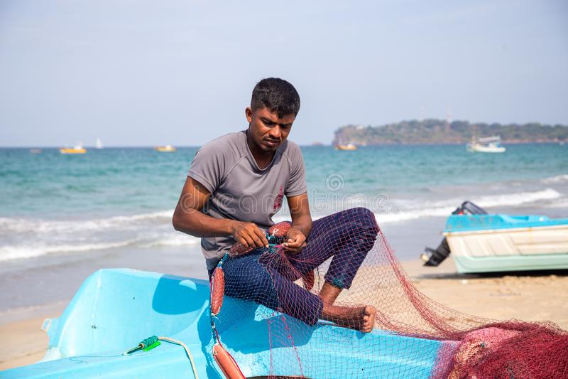 Fisherman at Trincomalee Beach, Sri Lanka royalty free stock photos