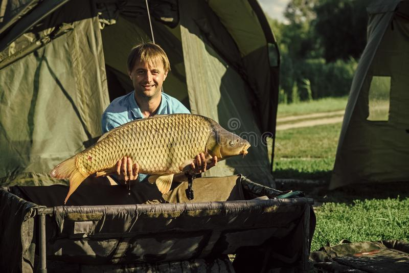 Fisherman with a trophy. Carp fishing, angling, fish catching stock photos