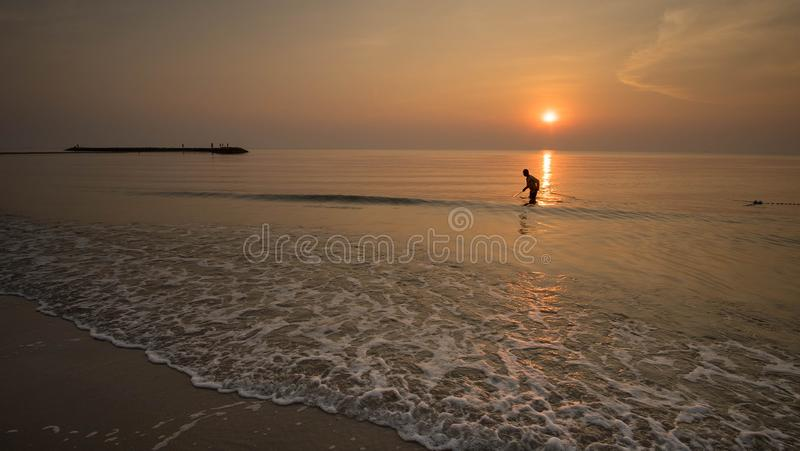 Krill hunter in the morning. The fisherman try to collect the krill for making the treditional food called Kapi in the morning royalty free stock image