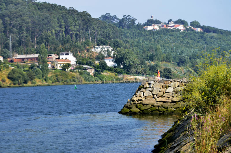 Fisherman. With two canes on Douro river stock photos