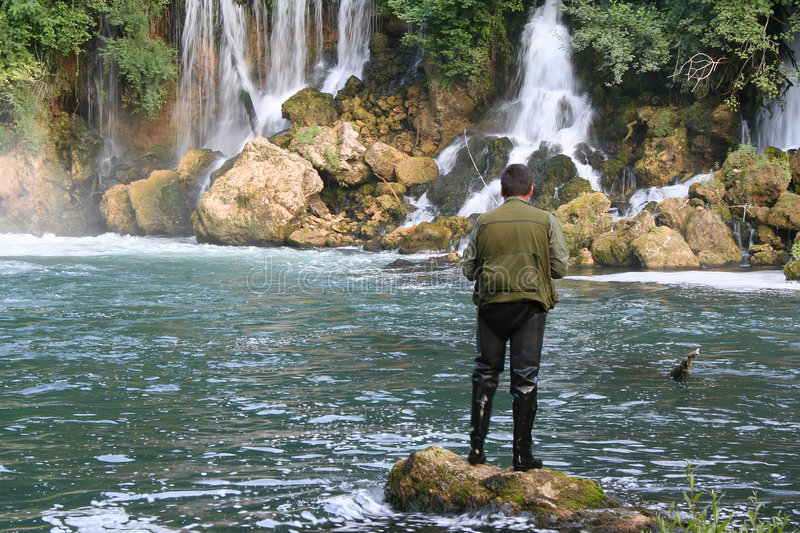 Fisherman and the waterfalls royalty free stock photo