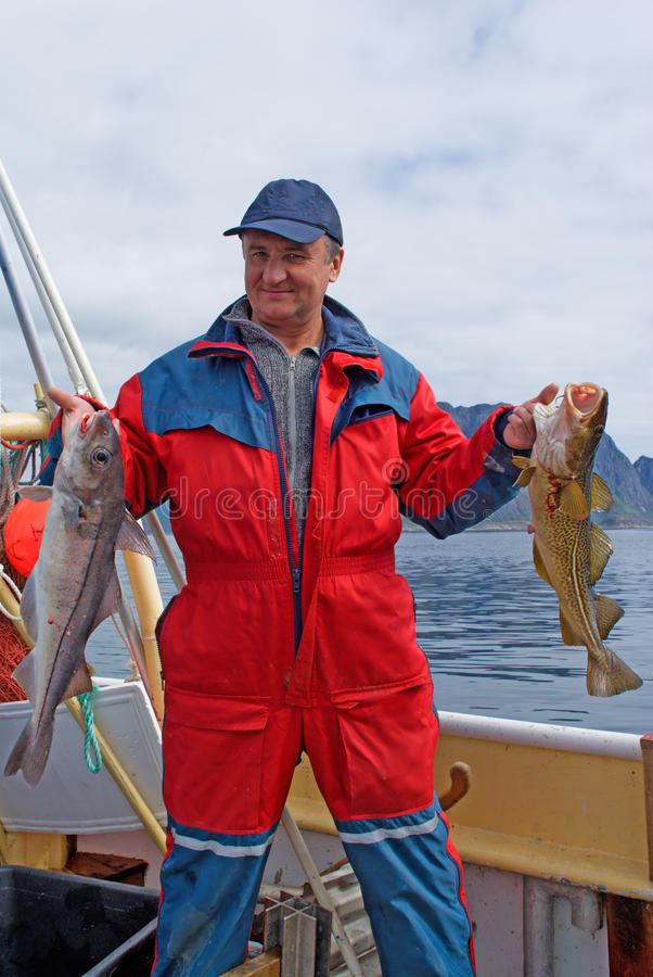 Free Fisherman With Fish On The Boat Royalty Free Stock Photography - 15009027